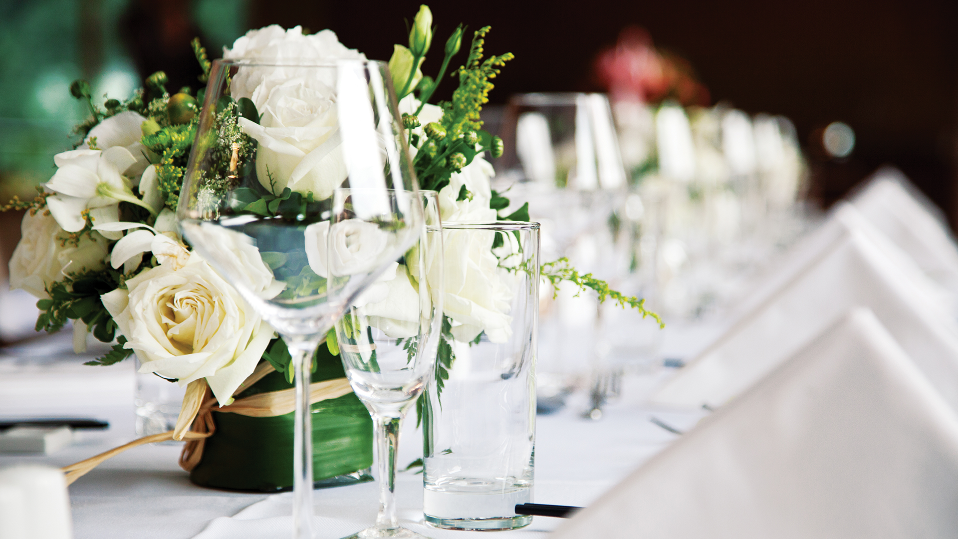 photo of table setting with flower arrangement